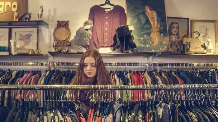 photo of woman near clothes